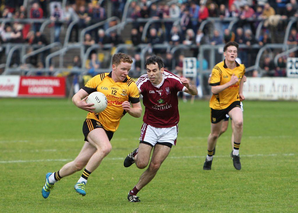 Jack Brady takes on Caolan McBreen. Photo: Adrian Donohoe.
